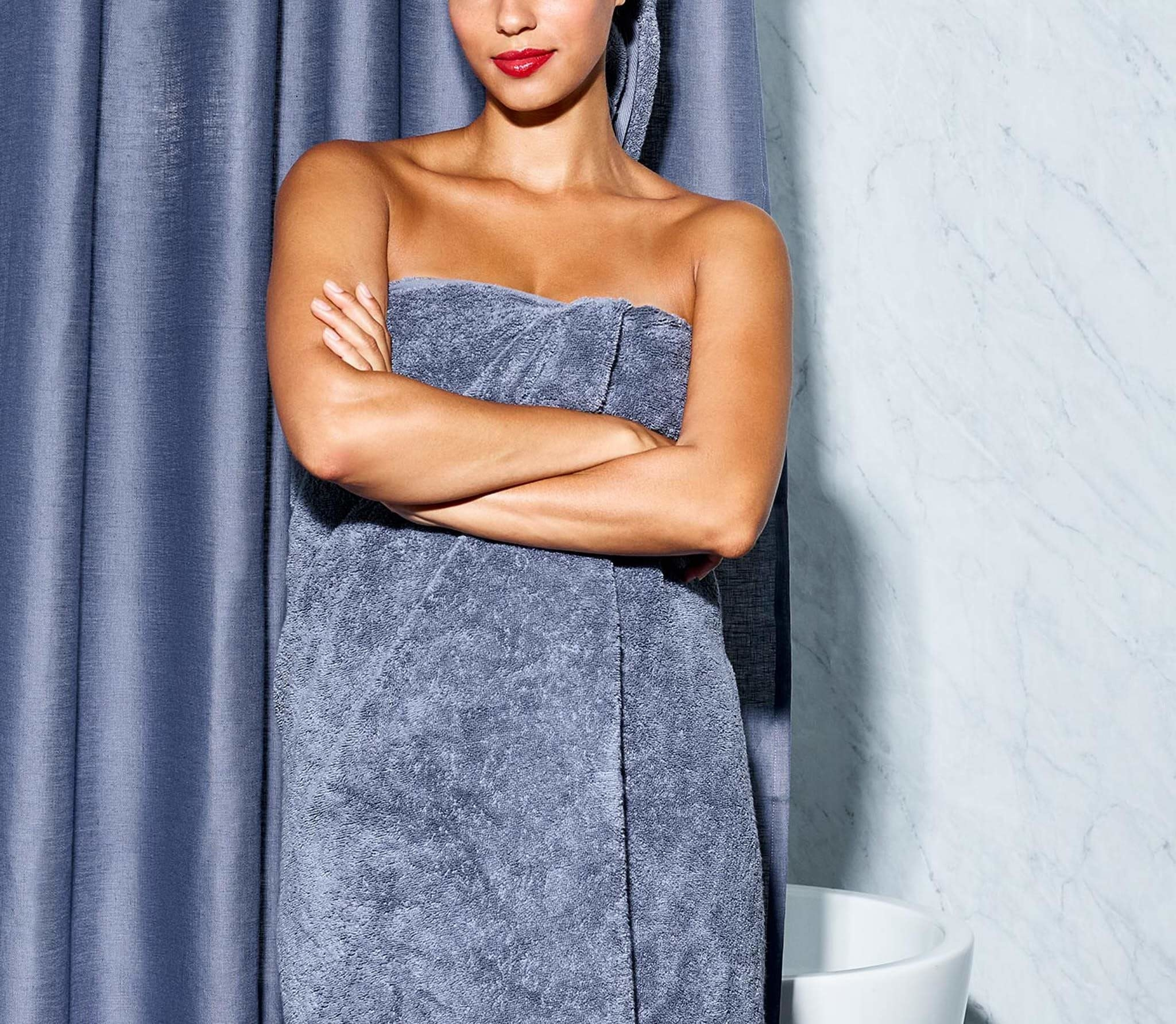 model wrapped in blue towel