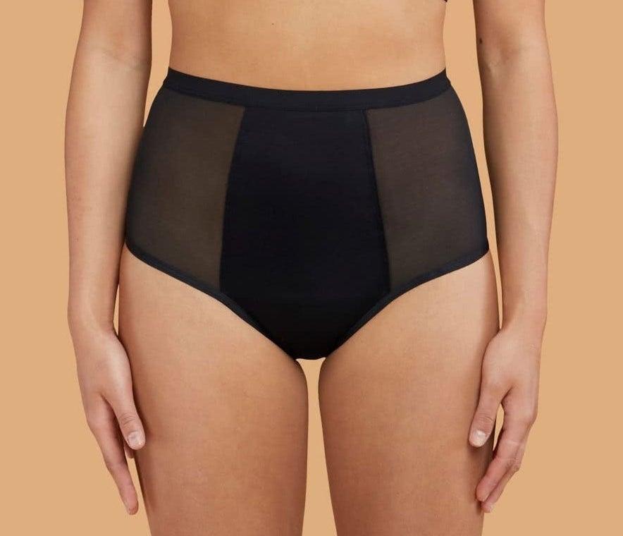model wearing high-waisted black underwear