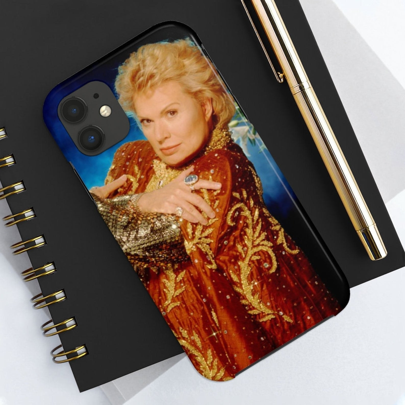 A smartphone cover featuring an image of Walter Mercado with his arms crossed