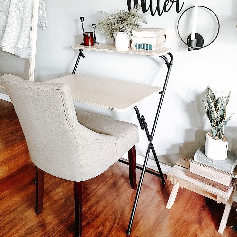 Two-tier wood-top desk with black metal crossing legs