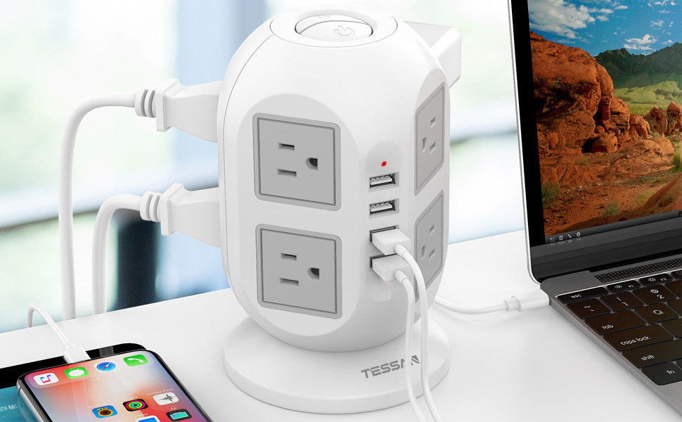 The tower-shaped charging hub with several devices plugged into it