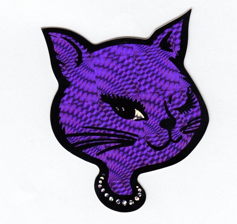 A holographic violet winky cat sticker