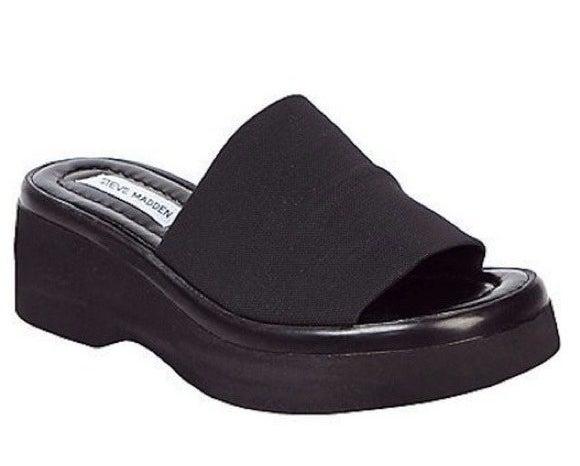 A black platformed Steve Madden slide sandal