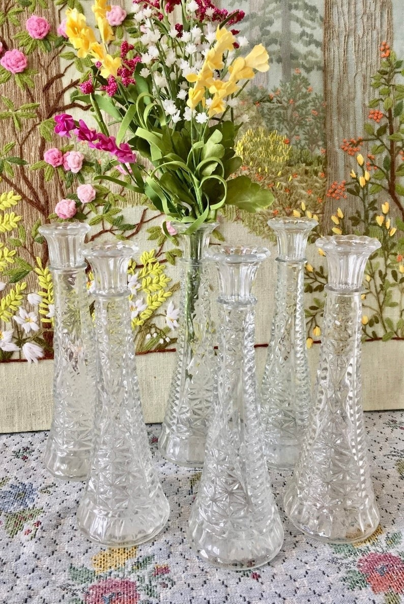 A collection of six clear crystal vases