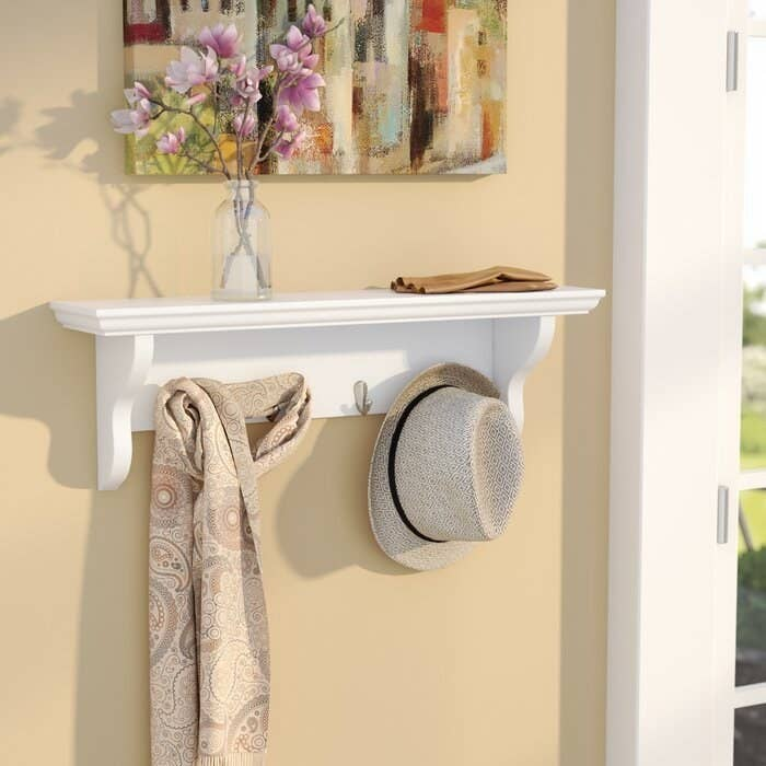 The white wall mount in an entryway