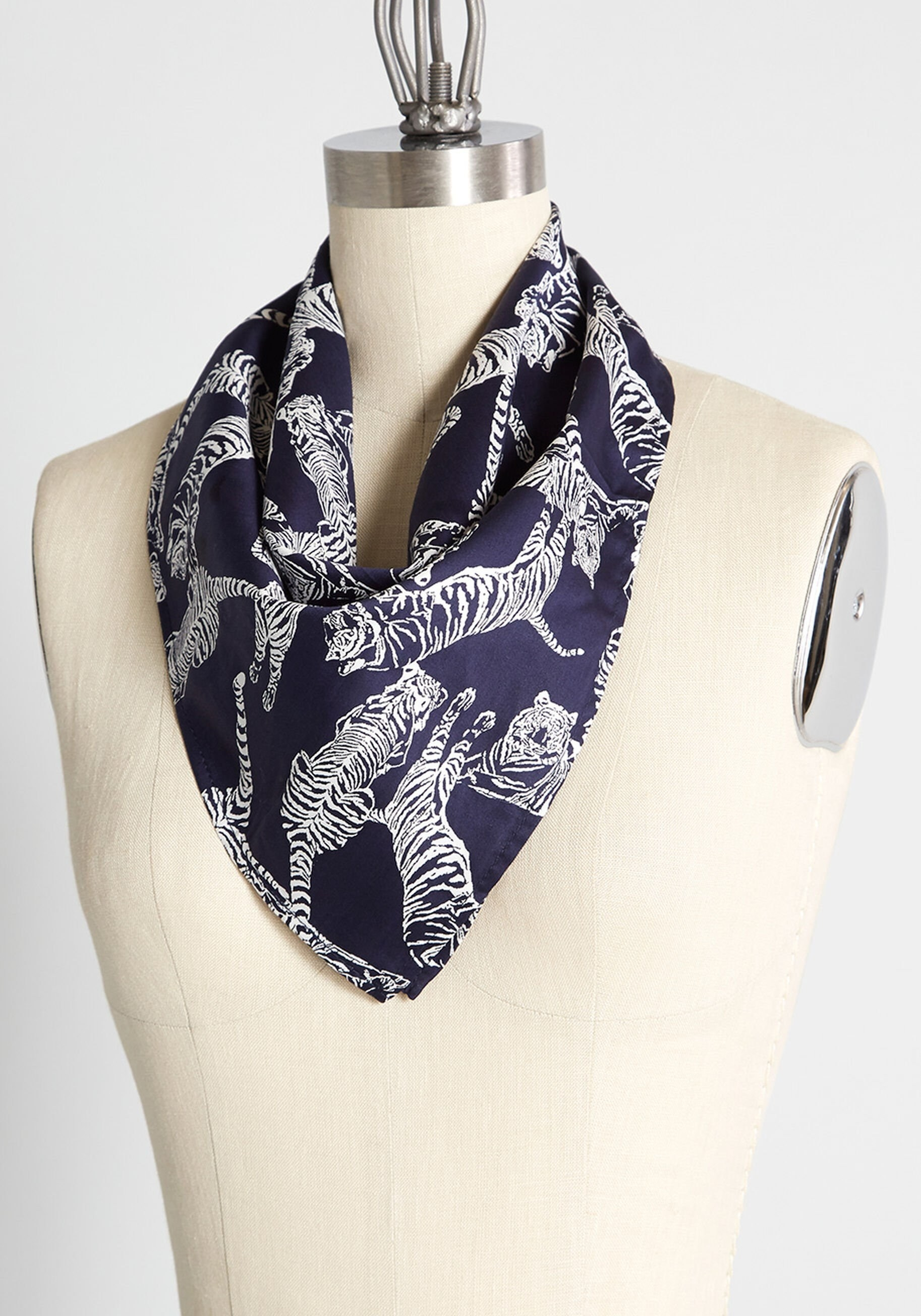 a navy bandana with white illustrations of tigers on it