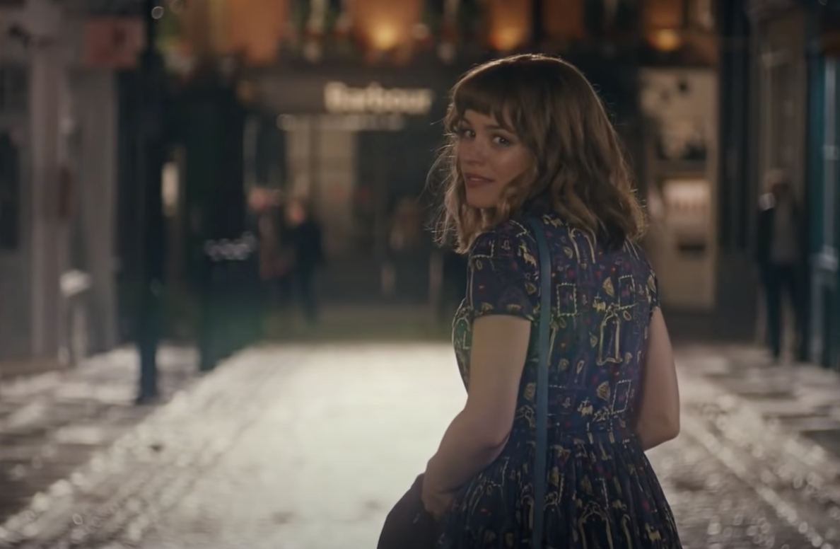 A romantically shot image of Rachel McAdams looking back in the middle of an empty street