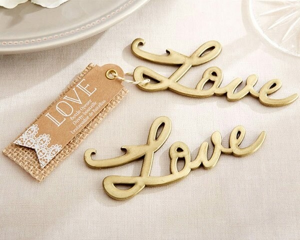 "a gold bottle opener shaped like the actual letters in the word ""love."" The bottle-opening part is on the top portion of the ""L""."