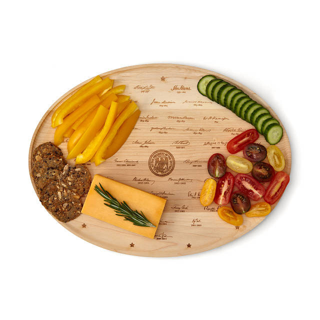 the platter with cheese and various other finger foods on it