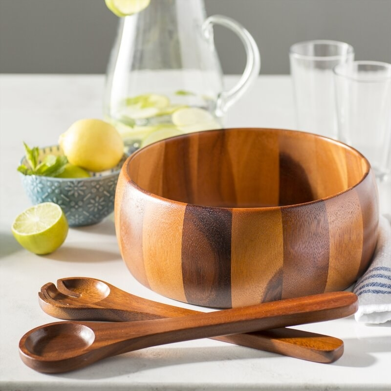 a wood grain finished bowl with two wooden spoons for scooping