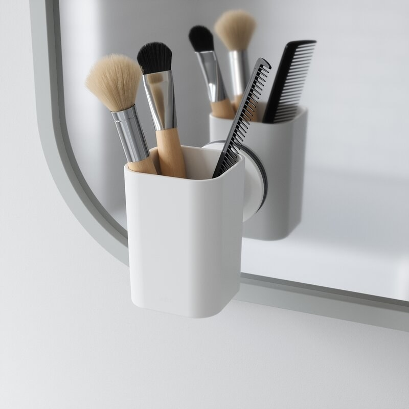 The small organizer suction-cupped to a mirror