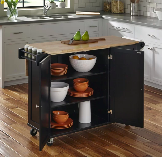 the kitchen cart with a brown wooden top and a black undercarriage