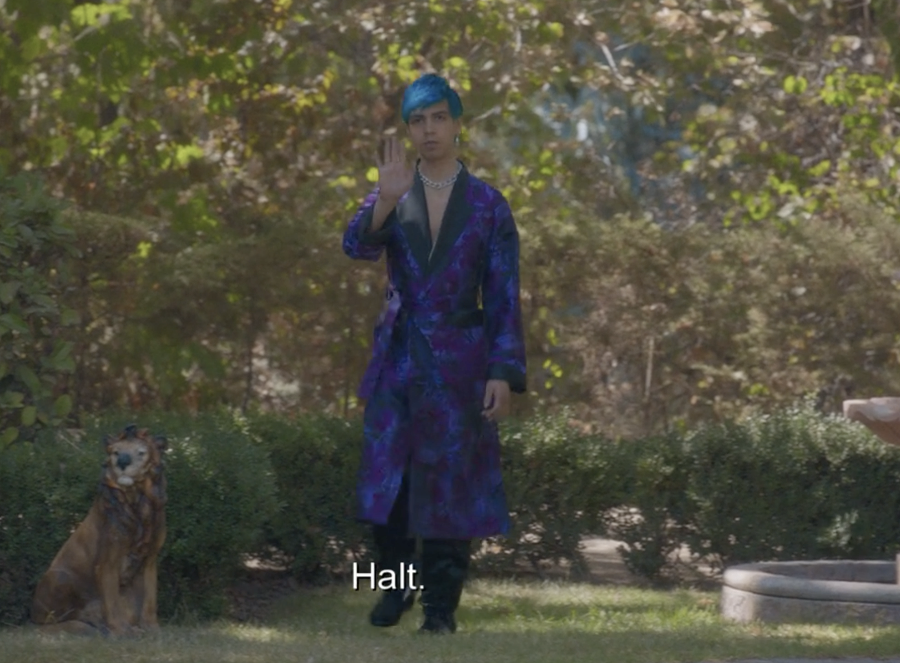 Andres wearing a blue knee-length robe with black trim and bright blue floral accents
