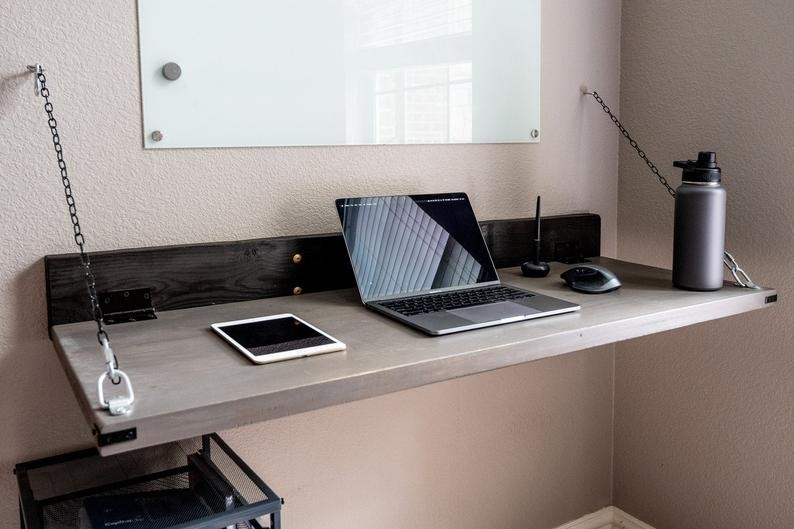 The Solid Wood Wall Mounted Rustic Folding Desk in an office