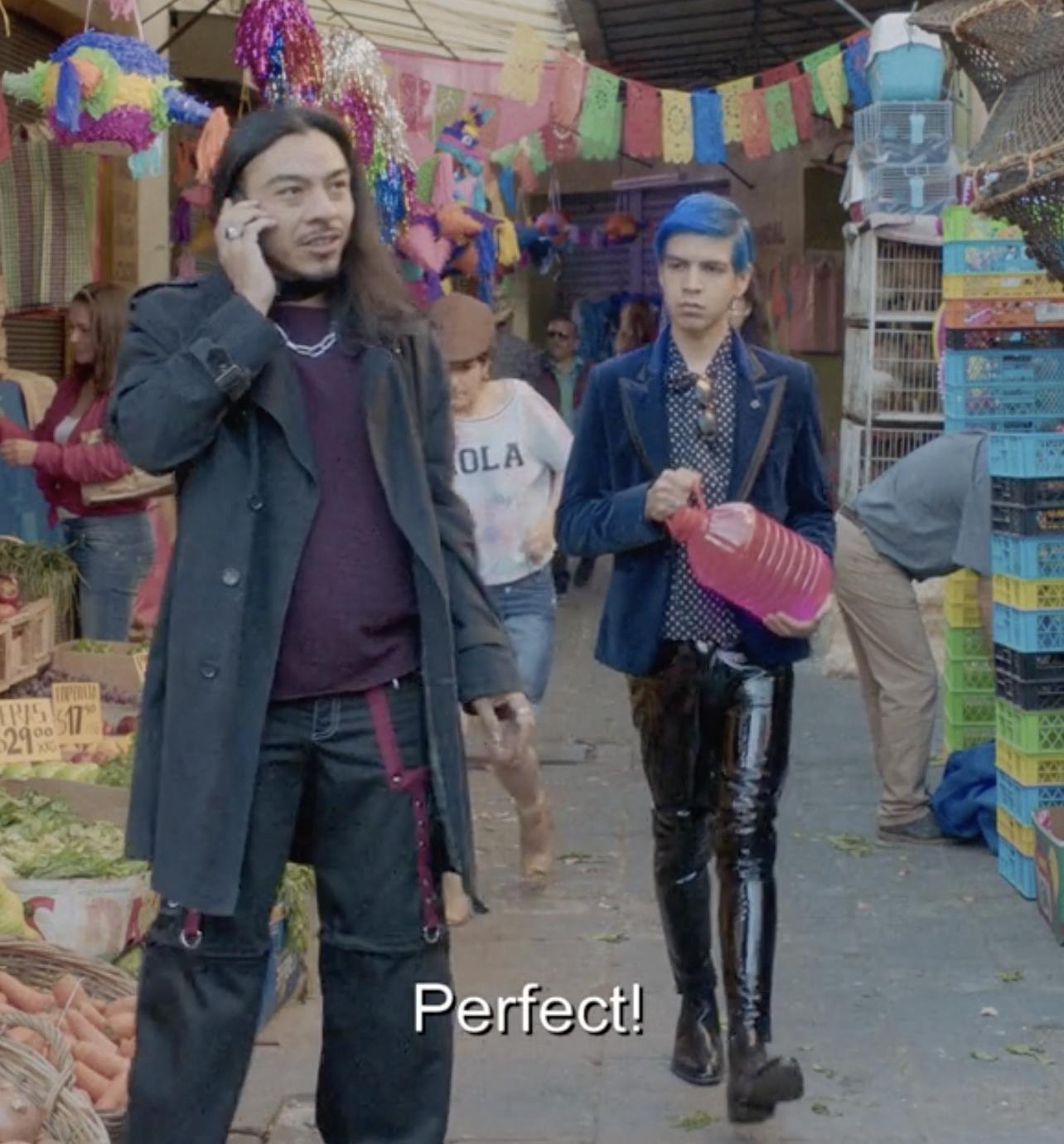 Andres walking towards Renaldo at an outdoor market