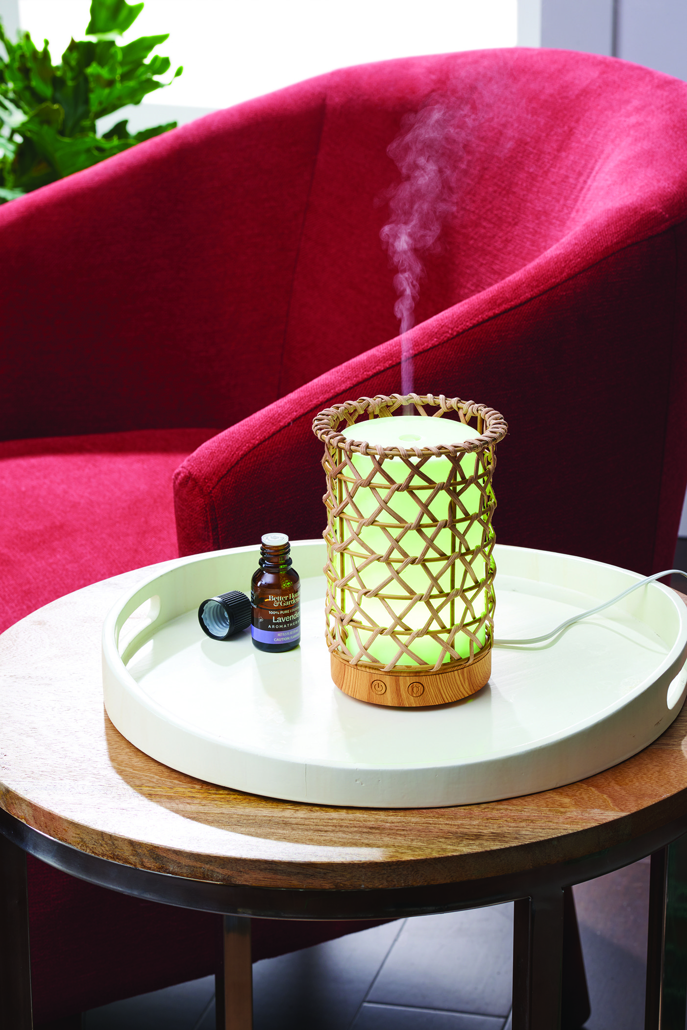 A wooden rattan diffuser on an end table