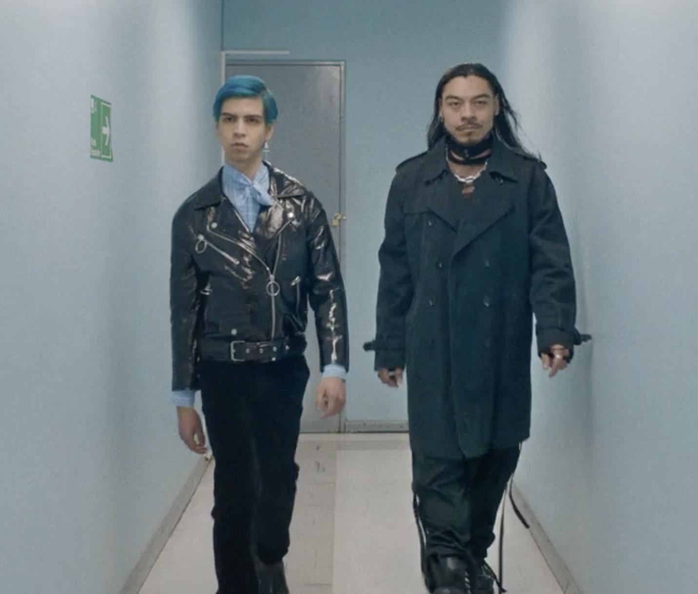 Andres walking with Renaldo down a hallway