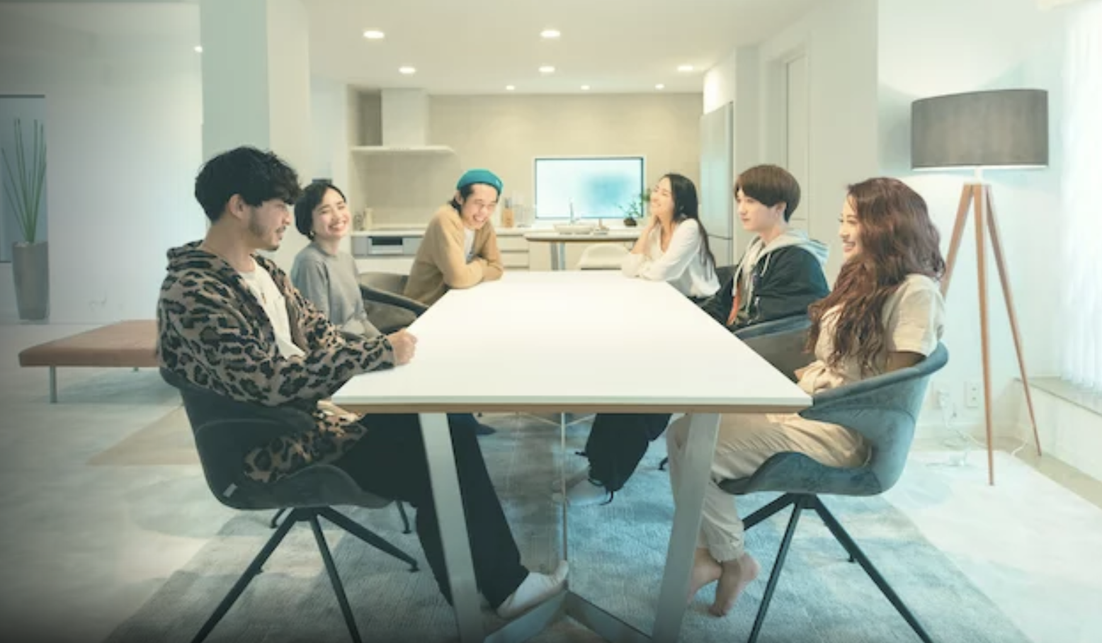 The cast of Terrace House gathered around the table.