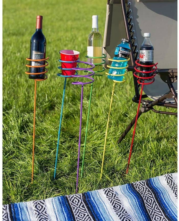 The set of six colored stakes holding full-size wine bottles, soda bottles, and Solo cups