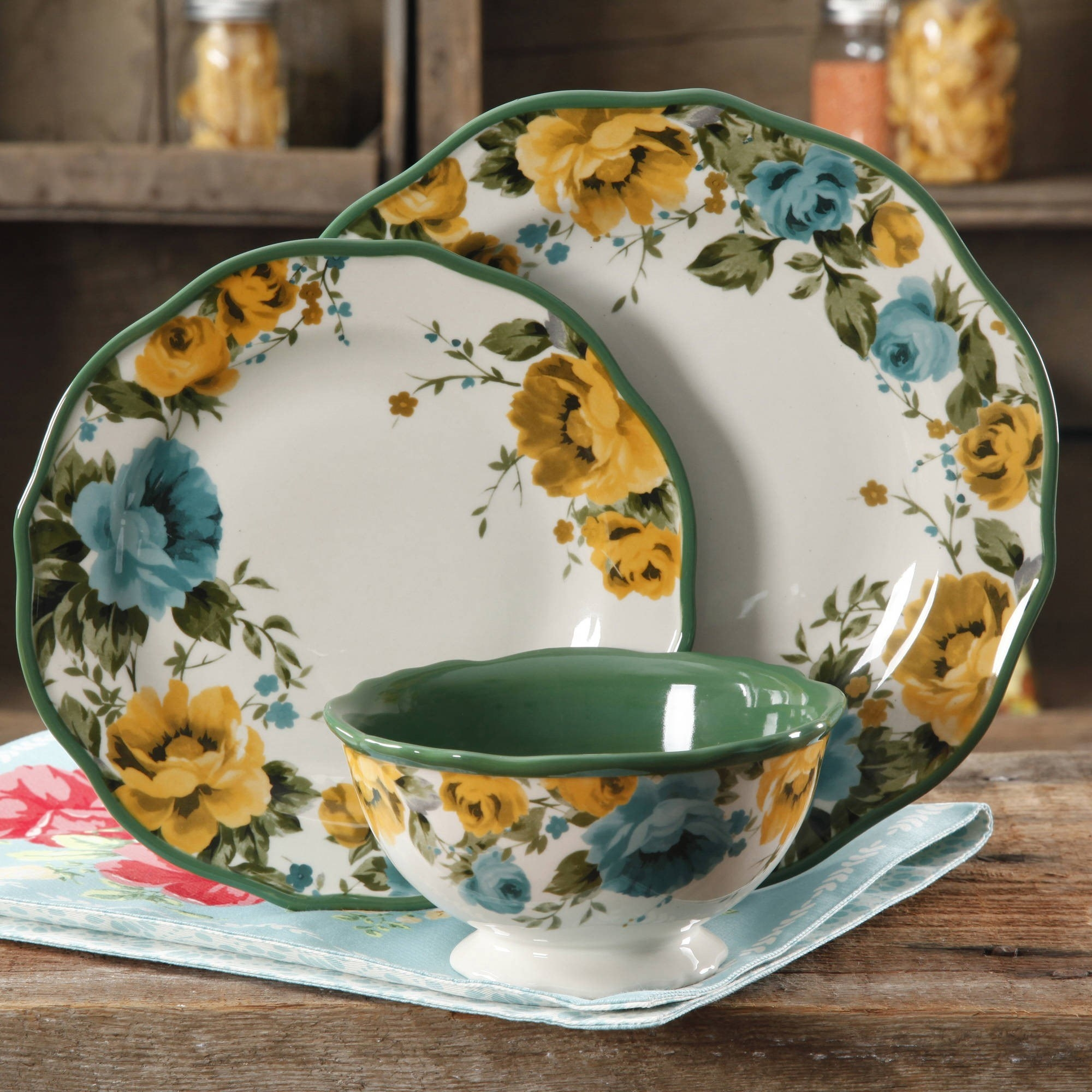 A set of evergreen and floral plates sitting on a counter