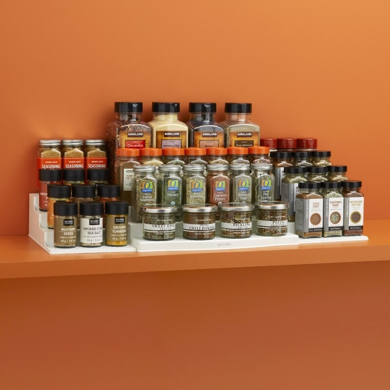 The expandable shelf riser with spices lined up