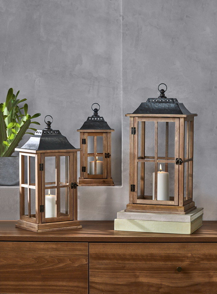 wooden candle lanterns sitting on a shelf