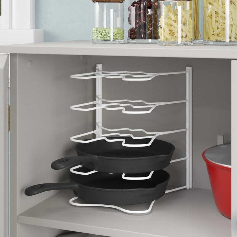 The kitchen pan divider in cabinet