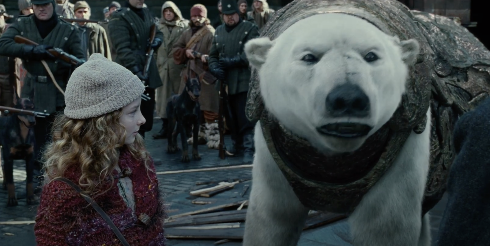 A young girl looks at a polar bear in the film