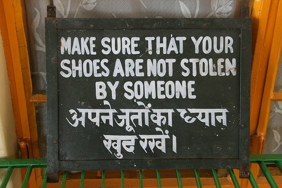 a warning that asks people to make sure that their shoes are not stolen by someone