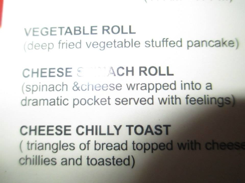 a menu with an item called cheese spinach roll which is described as spinach and cheese wrapped into a dramatic pocket served with feelings
