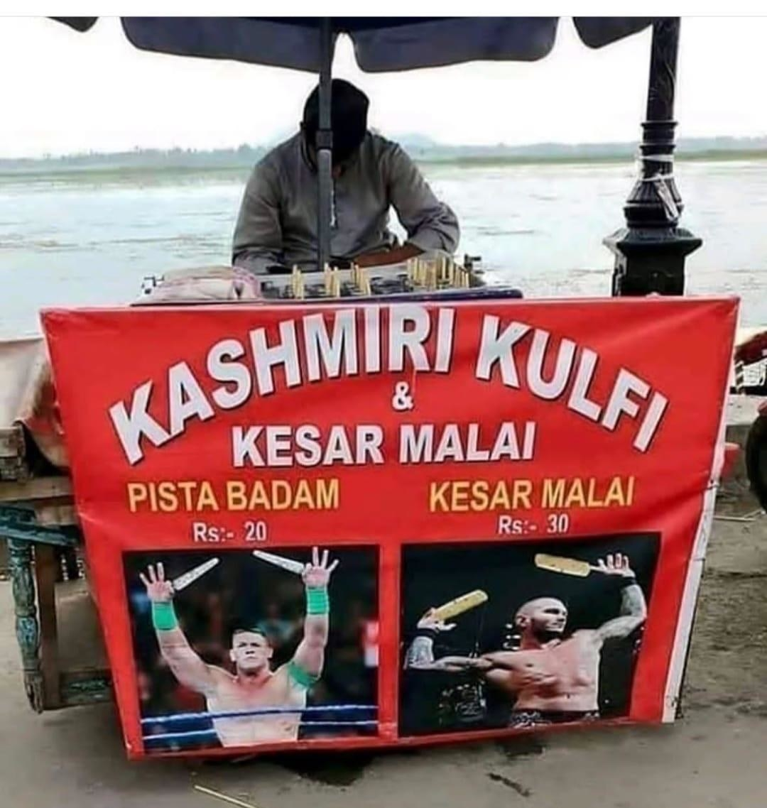 a man guards his kashmiri kulfi stand that apparently is endorsed by popular wrestlers such as john cena