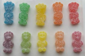 Sour Patch Kids from America next to ones from Australia, looking different