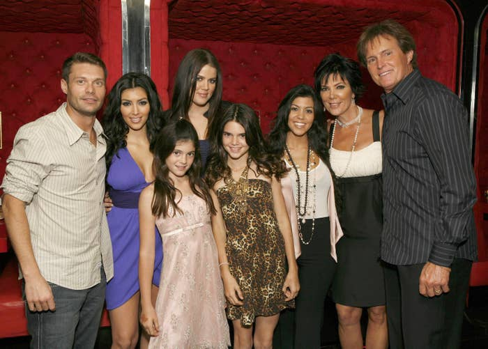 """Ryan Seacrest, Kim Kardashian, Kylie Jenner, Khloe Kardashian, Kendall Jenner, Kourtney Kardashian, Kris Jenner and Bruce Jenner pose for a photo at the """"Keeping Up With the Kardashians"""" viewing party at Chapter 8 Restaurant on October 16, 2007."""