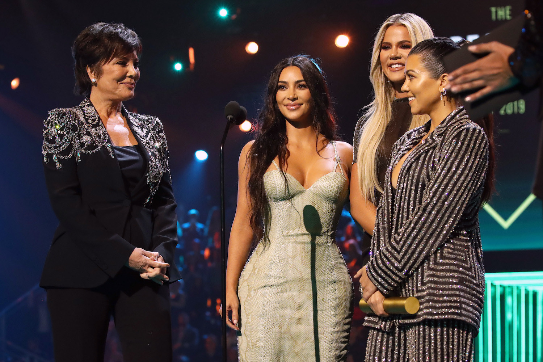 Kris Jenner, Kim Kardashian, Khloe Kardashian, and Kourtney Kardashian accept The Reality Show of 2019 for 'Keeping Up with the Kardashians' on stage during the 2019 E! People's Choice Awards.