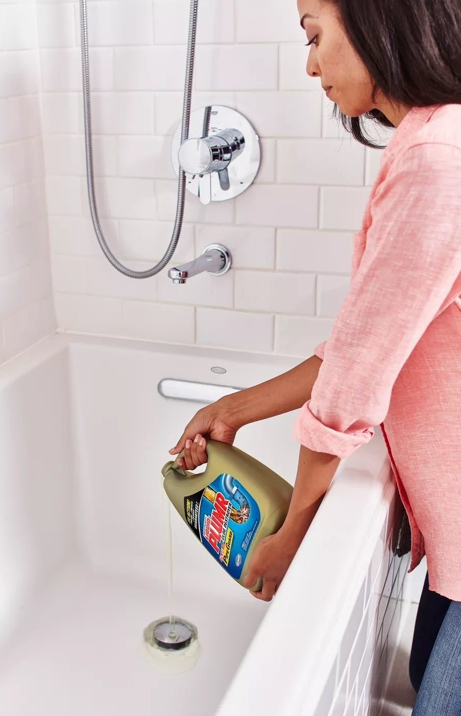 A model pouring Liquid Plumr Clog Destroyer Gel with PipeGuard down the shower drain