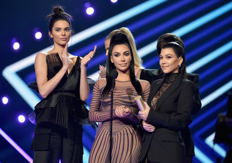 Kendall Jenner, Khloe Kardashian, KIm Kardashian, Kourtney Kardashian, and Kris Jenner accept The Reality Show of 2019 for 'Keeping Up with the Kardashians' on stage during the 2019 E! People's Choice Awards.