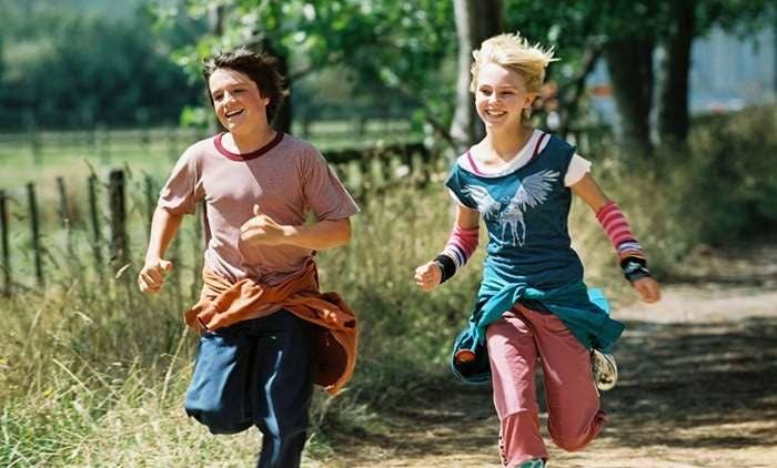 Jess and Leslie running along a dirt road looking happy