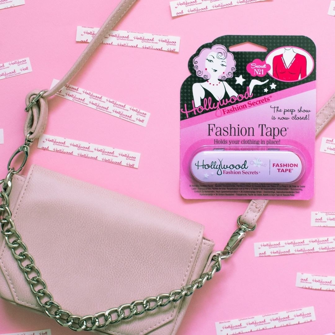 A purse surrounded by fashion tape strips