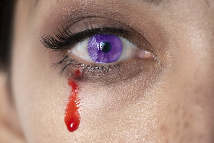 purple eye with bloody tear coming out of it