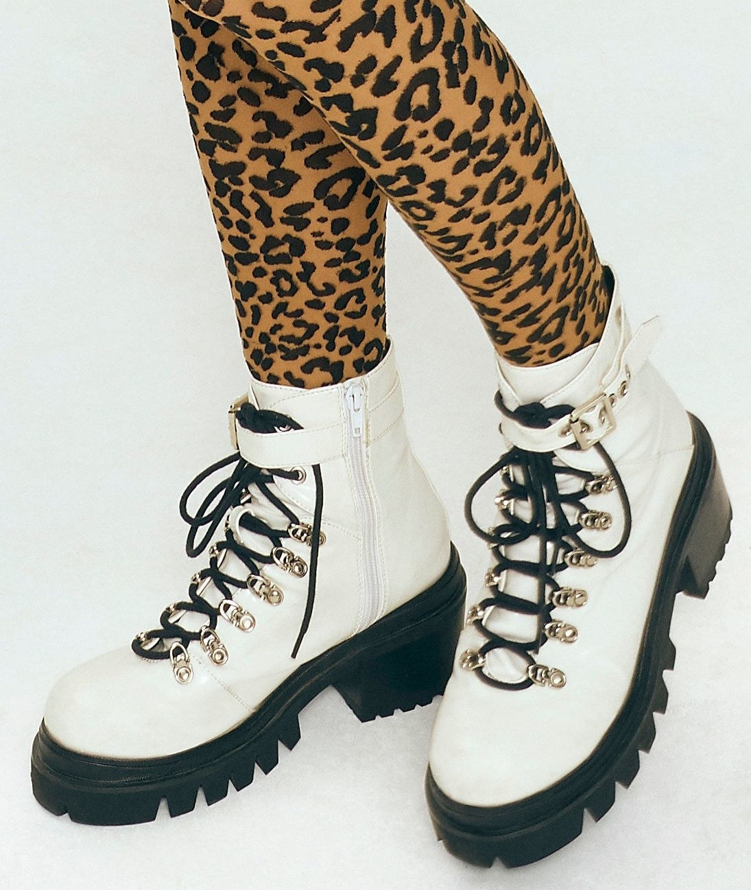 Model wearing the combat boots in white