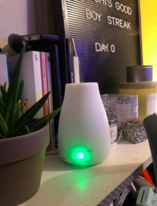 reviewer pic of the diffuser on a bookshelf