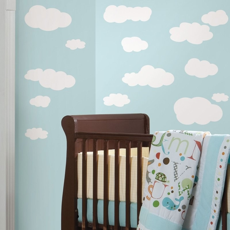 White cloud decals of various sizes on a blue wall