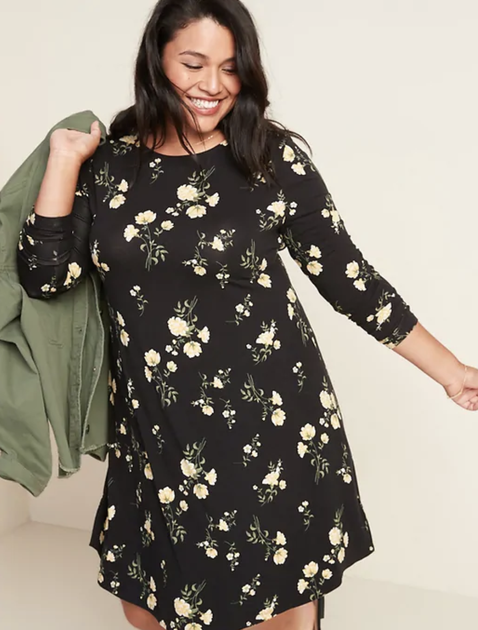 Model in black 3/4-sleeve swing dress with white florals