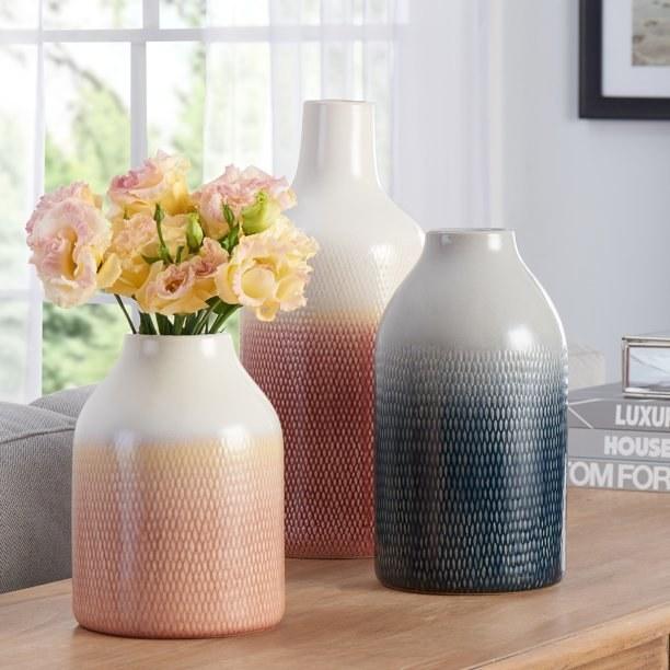 The three piece vase set in light pink, blue, and dark pink