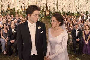 Edward and Bella standing at the altar at their wedding in twilight