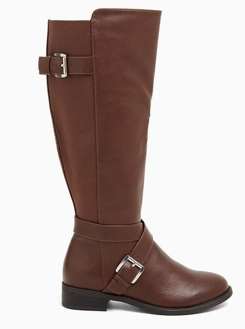 The knee-high brown leather boot with silver buckles