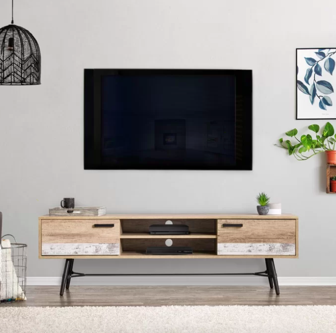 Beige and gray wooden TV stand with two side shelves below a flat-screen TV