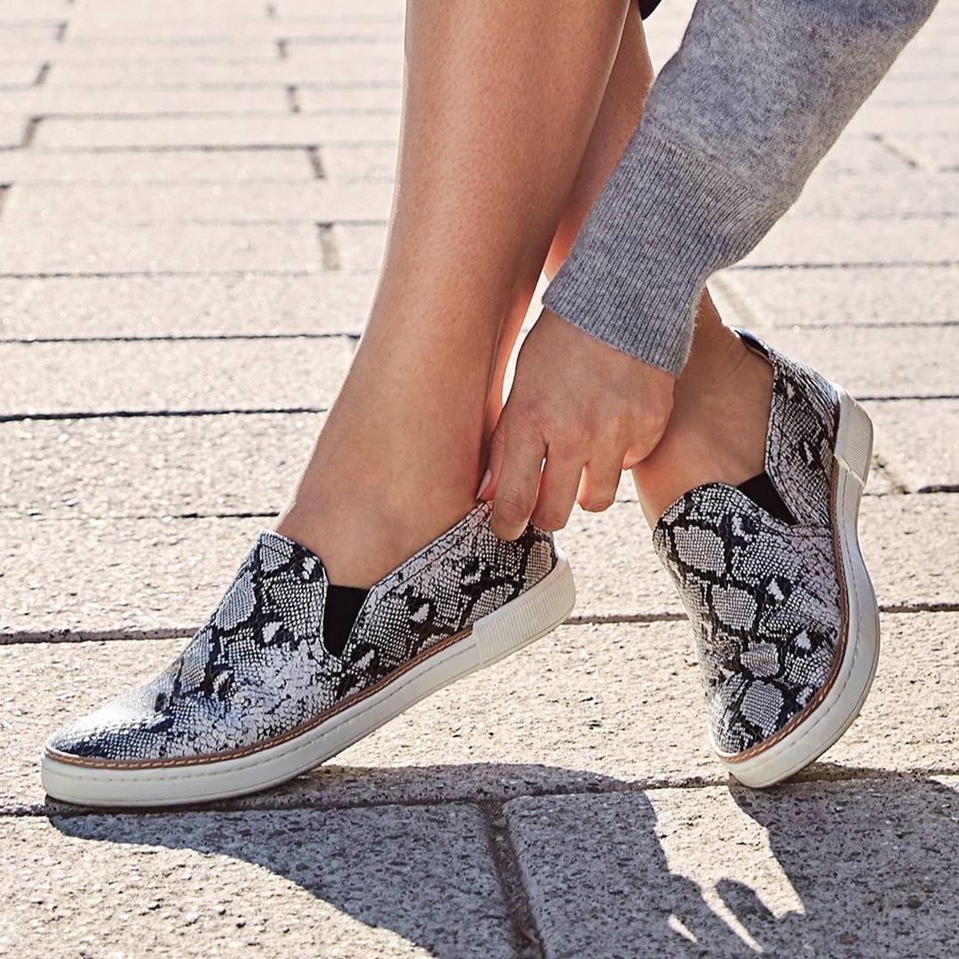 Model wearing the snakeskin slip on sneakers