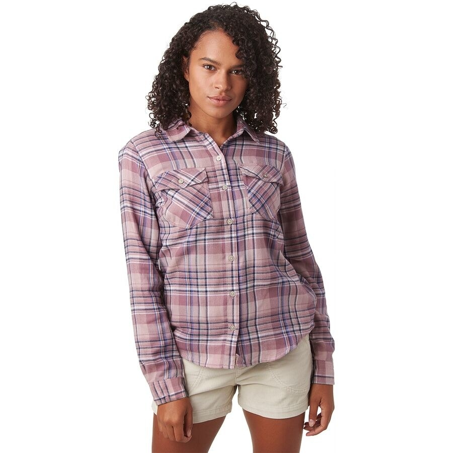 A model in the pale pink, blue, and white plaid shirt
