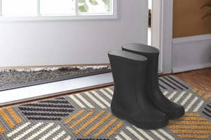 mat at door with boots on it